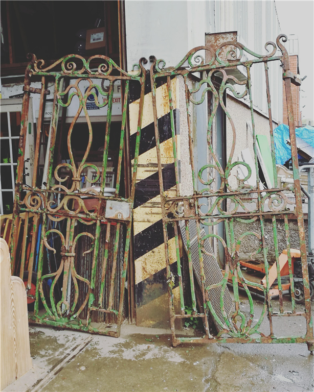 Old & original very heavy cast iron double gates. Gallery Image