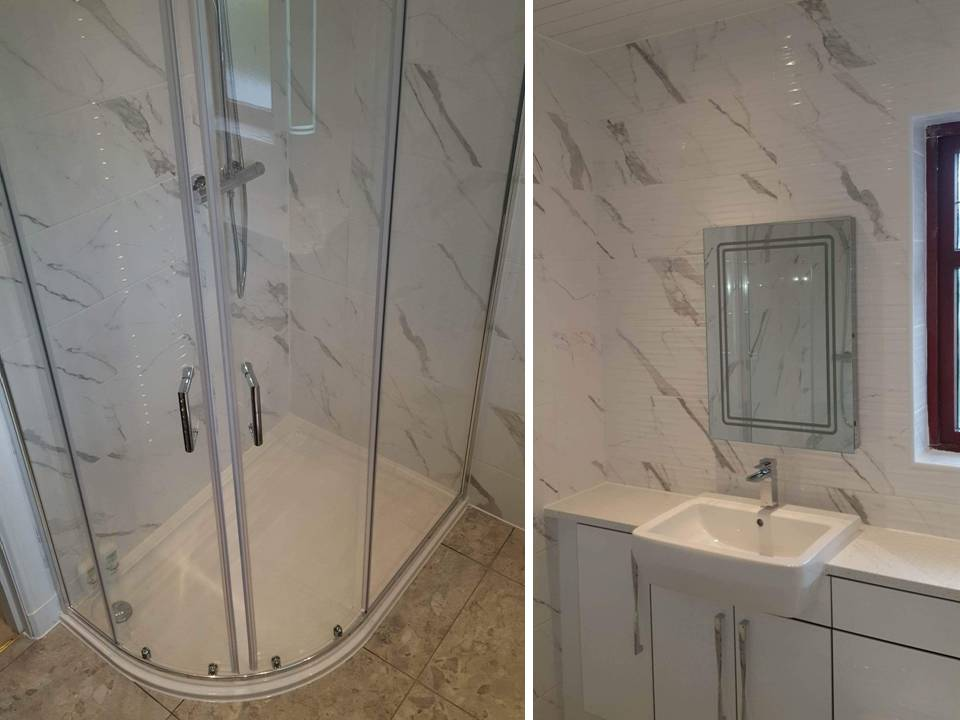 fitted bathroom with carrara marble effect tiles and made to measure vanity units Gallery Image