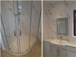 fitted bathroom with carrara marble effect tiles and made to measure vanity units Gallery Thumbnail