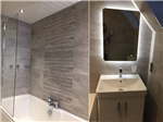 fitted bathroom with waterfall tiles and led mirror Gallery Thumbnail