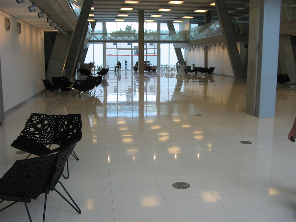 white quartzstone tile bonded onto our calcium sulphate raised floor panel Gallery Image