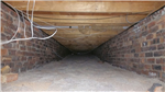 Underfloor insulation from outside your home. Before picture. Call us for advice on access. Gallery Thumbnail