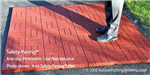 non slip patio - safety paving - red - man standing on tile Gallery Thumbnail