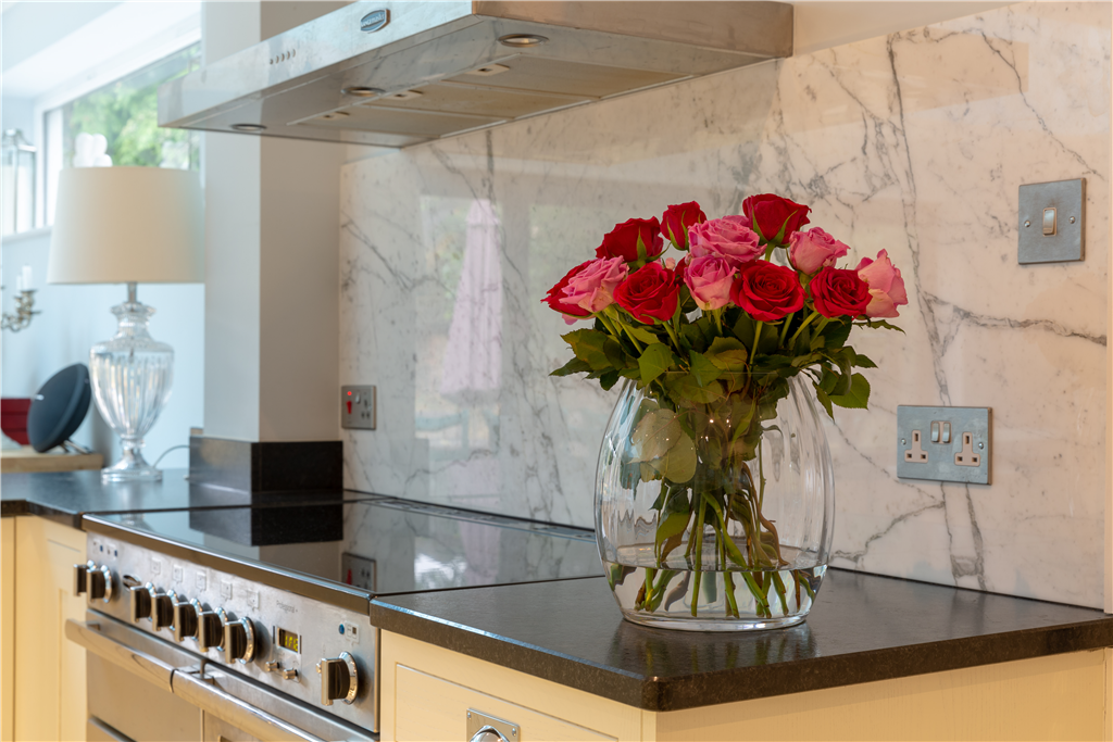 Anhara black leathered finish granite worktops & Arabescato marble splashback, Surrey. Gallery Image
