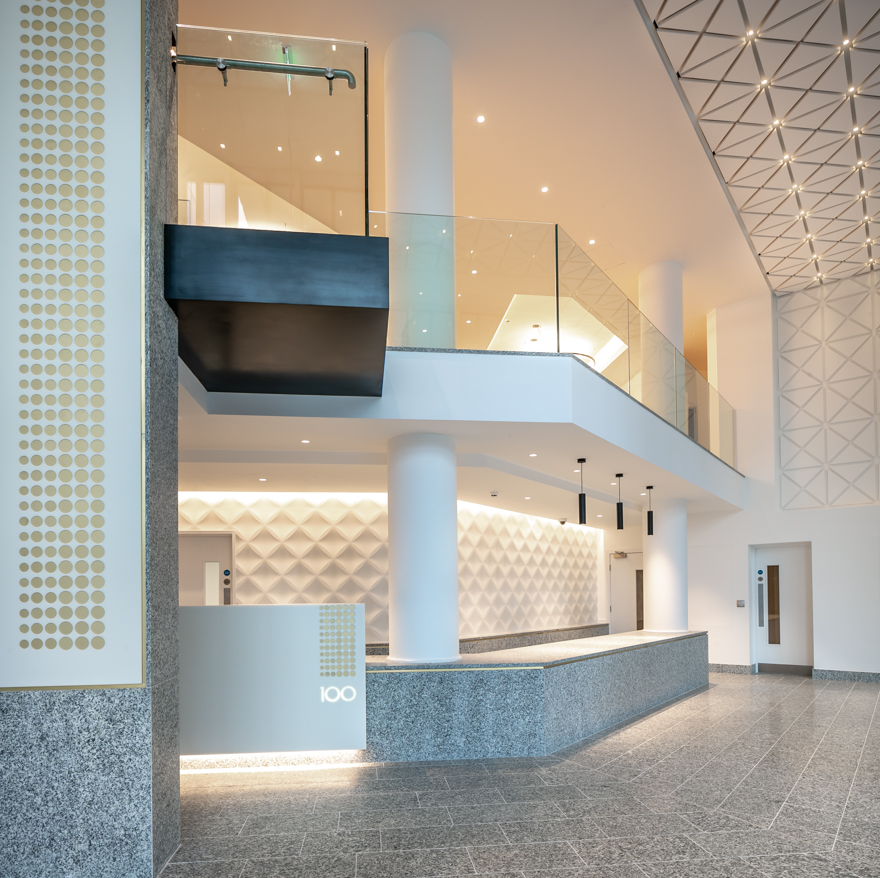 Serizzo Antigorio granite floor tiles, wall cladding and reception desk, Exchange Court, Manchester. Gallery Image