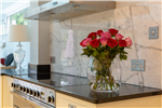 Anhara black leathered finish granite worktops & Arabescato marble splashback, Surrey. Gallery Thumbnail