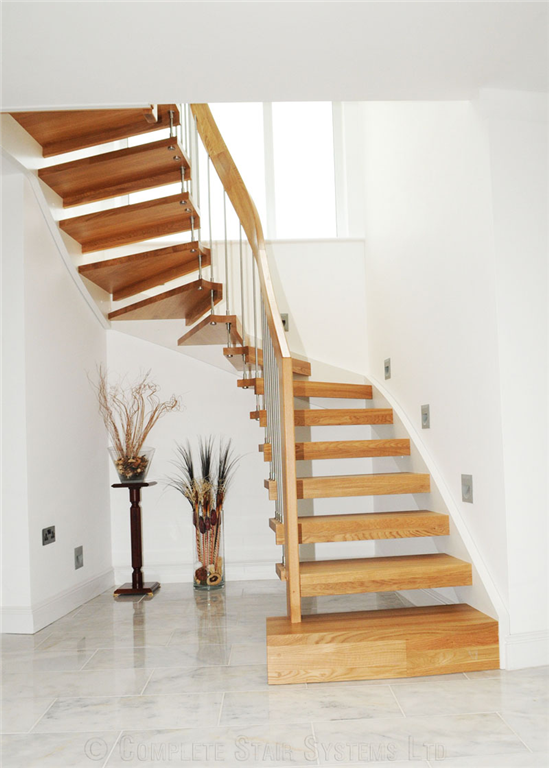 Bespoke Beech 1/2 turn, with integrated L-shape riser in-fills, cover painted stringer and curved handrail  Gallery Image