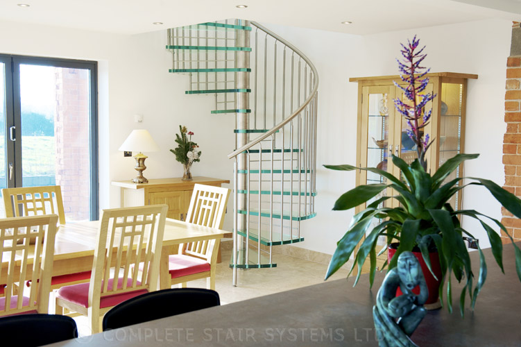 Bespoke Spiral Stair with 30mm laminated glass treads and vertical steel balustrade  Gallery Image