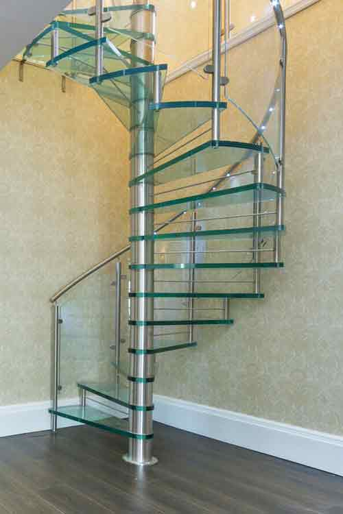 Bespoke Spiral Stair with 30mm laminated glass treads and curved glass balustrade  Gallery Image