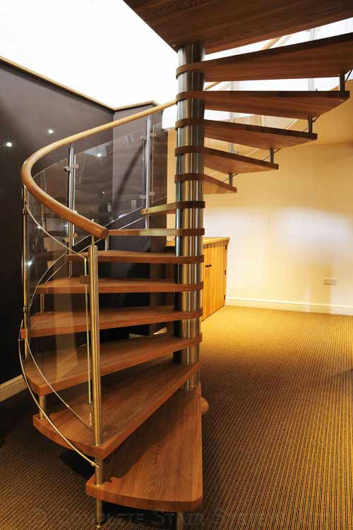 Bespoke Spiral stair with curved glass balustrade and varnished oak treads Gallery Image