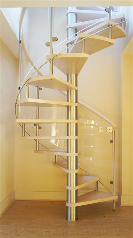 Bespoke Spiral Stair with curved glass balustrade, beech stained treads and handrail Gallery Image