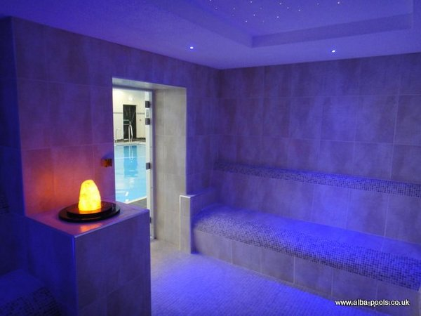 De luxe commercial steam room with illuminated crystal feature and ceiling mounted colour changing fibre optic lighting system. Gallery Image