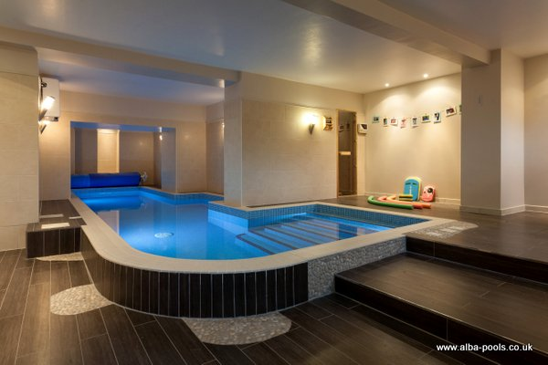 9.00 x 2.00 domestic skimmer design mosaic tiled pool with swim jet, in a basement Gallery Image
