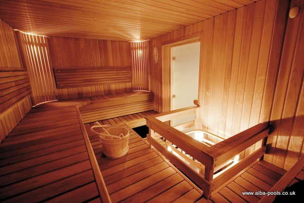This deluxe sauna design features walls and benches of heat-treated aspen, to stunning effect. Gallery Image