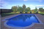 Outdoor swimming pool, skimmer design. Size: 8.00 x 4.00 metres, with semi-circular roman end step unit. Panel pool construction with a vinyl liner finish in mosaic tile pattern.  Gallery Thumbnail