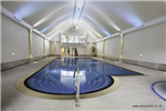 Large and luxurious deck level swimming pool with concealed (floor pit mounted) automatic pool cover system, roman end steps and spa. Stretch ceiling with feature lighting. Gallery Thumbnail