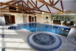 Skimmer pool with mosaic pattern liner, step unit and overflow spa pool. Gallery Thumbnail